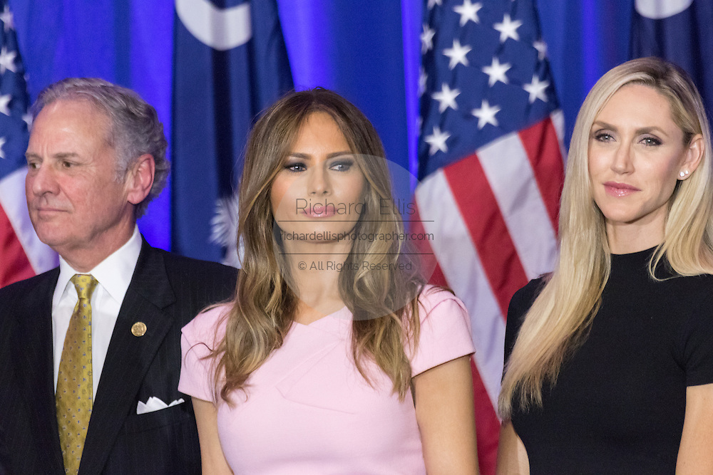 Melanie Trump, center, stands with Lara Yunaska and Lt. Gov. Henry McMasters during the victory celebration of billionaire and GOP presidential candidate Donald Trump in the South Carolina Republican primary February 20, 2016 in Spartanburg, South Carolina, USA .
