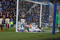 Football - 2018 / 2019 Premier League - Brighton and Hove Albion vs. Newcastle United<br /> <br /> Glenn Murray of Brighton sinks to his knees as Shane Duffy and Lewis Dunk end up on the floor as Murry's header goes just over the bar at The Amex Stadium Brighton <br /> <br /> COLORSPORT/SHAUN BOGGUST