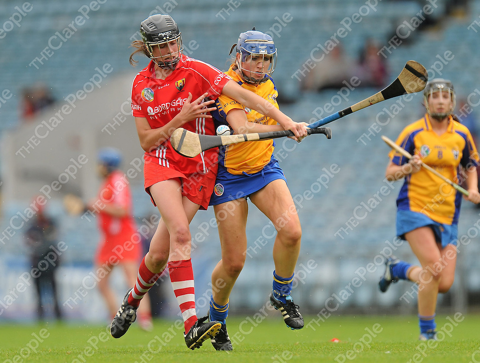 4 August 2012; Orla Cotter, Cork, in action against Kate Lynch, Clare. All-Ireland Senior Camogie Championship Quarter-Final, Cork v Clare, Páirc Ui Chaoimh, Cork. Picture credit: Pat Murphy / SPORTSFILE *** NO REPRODUCTION FEE ***