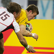 Rob Horne, Australia scores a try despite the efforts of Blaine Scully, USA,  during the Australia V USA, Pool C match during the IRB Rugby World Cup tournament. Wellington Stadium, Wellington, New Zealand, 23rd September 2011. Photo Tim Clayton..