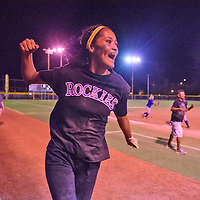 Rockies' catcher Adrianna Lynn celebrates after winning a U-14 softball championship at Ford Canyon Park in Gallup.