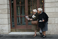 A couple of women study a map as the take a tour of Rome, Italy