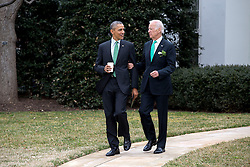 President Barack Obama and Vice President Joe Biden walk to the motorcade on the South Lawn of the White House for departure en route to the U.S. Capitol in Washington, D.C. for a St. Patrick's Day lunch, March 17, 2015. (Official White House Photo by Pete Souza)<br /> <br /> This official White House photograph is being made available only for publication by news organizations and/or for personal use printing by the subject(s) of the photograph. The photograph may not be manipulated in any way and may not be used in commercial or political materials, advertisements, emails, products, promotions that in any way suggests approval or endorsement of the President, the First Family, or the White House.