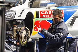 16.01.2014, Servicepark, Gap, FRA, FIA, WRC, Rallye Monte Carlo, 1.Tag, im Bild ein Mechaniker von Volkswagen Motorsport bei der Arbeit am Fahrzeug von OGIER Sebastien / INGRASSIA Julien ( VOLKSWAGEN MOTORSPORT (DEU) / VOLKSWAGEN POLO R ), Aktion / Action // during day one of FIA Rallye Monte Carlo held near Monte Carlo, France on 2014/01/16. EXPA Pictures © 2014, PhotoCredit: EXPA/ Eibner-Pressefoto/ Neis<br /> <br /> *****ATTENTION - OUT of GER*****