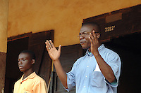 Ghana, Accra, Kokomlemle, 2007. The head teacher of the highest level at Kwameh Nkrumah Memorial School talks to the students about responsibility..