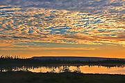Clouds at sunset over pond<br /> Hawke's Bay<br /> Newfoundland & Labrador<br /> Canada