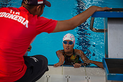 October 11, 2018 - Jakarta, Jakarta, Indonesia - Jakarta, Indonesia, 11 October 2018 : An athlete from Indonesia having coach time from her coach before the competition. Paraswim compettition at Aquatic Building in Gelora Bung Karno Jakarta on Asian Paragames 2018 Competition. (Credit Image: © Donal Husni/ZUMA Wire)