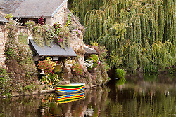 """Pontrieux, Brittany:  Settled in medieval times, this """"small town of character"""" is known for its half-timbered and dressed stone houses that date from the 16th to the 19th century and some 50 washhouses along the River Trieux that flows through the heart of town.  The town's 18th century fountain still flows today, a popular watering spot for both people and horses."""