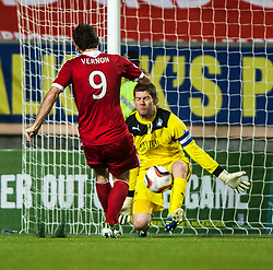 Falkirk's keeper Michael McGovern saves from Scott Vernon. Falkirk 0 v 5 Aberdeen, the third round of the Scottish League Cup.<br /> ©Michael Schofield.