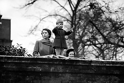 File photo dated 22/11/50 of Princess Elizabeth with her two year old son Prince Charles, watching the procession from the wall of Clarence House, as Queen Juliana and Prince Bernhard of the Netherlands drive to the Guildhall.