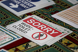 © Licensed to London News Pictures. 06/07/2020. London, UK. 'SORRY WUDU-TOILET CLOSED' sign, as all toilets within the Mosque will be closed. Wightman Road Mosque, also known as London Islamic Cultural Society and Mosque, in north London, prepares to open after the COVID-19 lockdown, by placing a number of measures required by law for worshippers. The government announced that gatherings of more than 30 worshippers are allowed for acts of communal worship in churches, synagogues, mosques, temples and other places of worship. All worshippers attending Mosques will have to wear face coverings and bring their own prayer mat, Quran, and a reusable shoe bag. Photo credit: Dinendra Haria/LNP