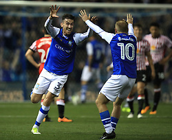 Sheffield Wednesday's David Jones celebrates their first goal with Barry Bannan (right)