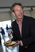Former Republican Governor Mark Sanford prepares a pulled pork BBQ sandwich during the Charleston Area Chamber of Commerce's Pork and Politics on April 30, 2013 in Charleston, South Carolina.
