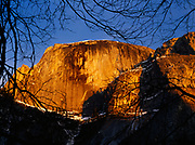 Vertical face of Half Dome viewed from Mirror Lake, Yosemite National Park, California.