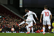 Christian Benteke of Liverpool takes a shot for goal but puts it wide. The Emirates FA cup, 4th round replay match, West Ham Utd v Liverpool at the Boleyn Ground, Upton Park  in London on Tuesday 9th February 2016.<br /> pic by John Patrick Fletcher, Andrew Orchard sports photography.