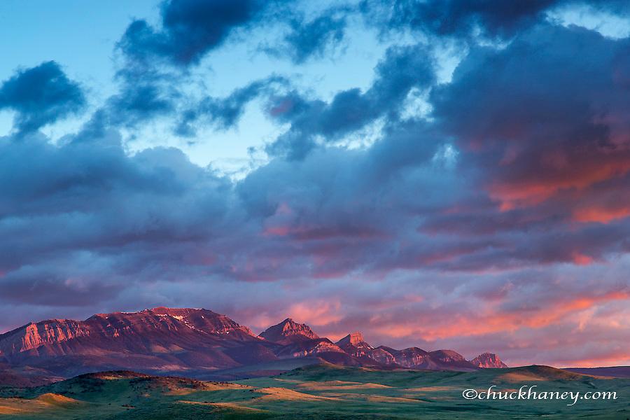 Fiery sunrise light strike Choteau Mountain along the Rocky Mountain Front near Choteau, Montana, USA