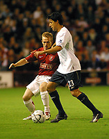 Photo: Dave Linney.<br /> Walsall v Bolton Wanderers. Carling Cup. 19/09/2006.<br /> Walsall's Dean Keats (L) closes in on Idan Tal