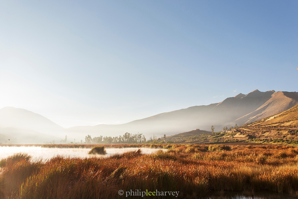 Sunrise over a lake in the Huacarpay Valley, Sacred Valley, Peru, South America