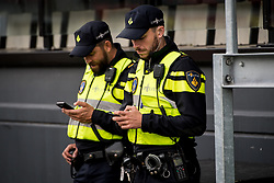 mobiele eenheid, police officers with their cellphones during the Dutch Eredivisie match between sbv Excelsior Rotterdam and sc Heerenveen at Van Donge & De Roo stadium on September 16, 2017 in Rotterdam, The Netherlands