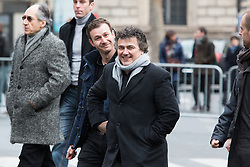 © Licensed to London News Pictures. 10/01/2016. France, Paris. Patrick Pelloux leaves after the anniversary ceremony on Place de le Republique surrounded by his 24/7 police protection alongside Charlie Hebdo Editor in Chief Gerard Biard (far left). Today January 10th 2016. Photo credit: Hugo Michiels/LNP