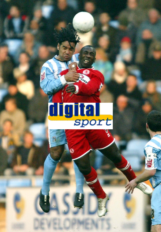 Photo: Chris Ratcliffe.<br />Coventry City v Middlesbrough. The FA Cup. 28/01/2006.<br />Jimmy Floyd Hasselbaink (R) of Boro and Richard Shaw of Coventry go for an aerial ball.