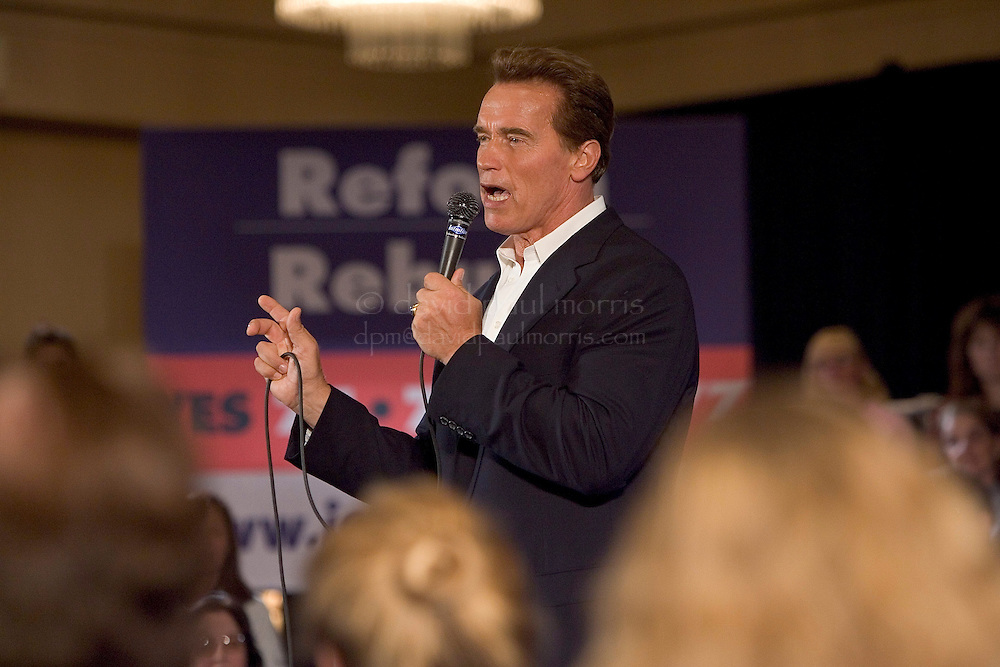 """OAKLAND, CA - OCTOBER 10: California Governor Arnold Schwarzenegger and U.S. Senator John McCain appear during the """"Conversations with California Women"""" Town Hall style meeting October 10, 2005 in Oakland, California. Governor Schwarzenegger was joined by U.S. Senator John McCain (R-AZ) on the campaign trial after McCain announced his support of the Governors controversial Propositions 74, 75, 76 and 77.  Photo by David Paul Morris"""