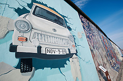 Mural of Trabant car painted on Berlin Wall at the East Side Gallery in Friedrichshain in Berlin