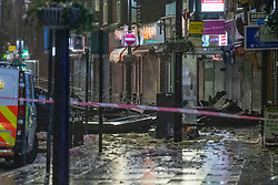 © Licensed to London News Pictures. 14/01/2020. Slough, UK. Debris from a section of metal roof sits on the High Street in Slough after winds from storm Brendon tore it from the top of a building. Photo credit: Peter Manning/LNP