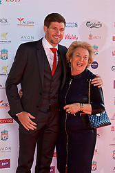 LIVERPOOL, ENGLAND - Tuesday, May 9, 2017: Liverpool's Steven Gerrard with Carol Farrell from the Melwood canteen on the red carpet for the Liverpool FC Players' Awards 2017 at Anfield. (Pic by David Rawcliffe/Propaganda)