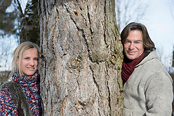Portrait of couple standing by tree, smiling, Bavaria, Germany