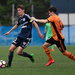 BRISBANE, AUSTRALIA - NOVEMBER 12: Cameron McGilp of the Victory dribbles the ball under pressure from Shannon Brady of the Roar during the round 1 Foxtel National Youth League match between the Brisbane Roar and Melbourne Victory at Spencer Park on November 12, 2016 in Brisbane, Australia. (Photo by Patrick Kearney/Brisbane Roar)