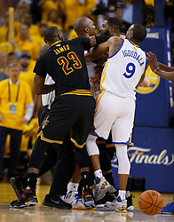The Golden State Warriors' David West (3) gets into it with the Cleveland Cavaliers' Tristan Thompson (13) in the second quarter of Game 5 of the NBA Finals at Oracle Arena in Oakland, Calif., on Monday, June 12, 2017. (Photo by Nhat V. Meyer/Bay Area News Group/TNS) *** Please Use Credit from Credit Field ***