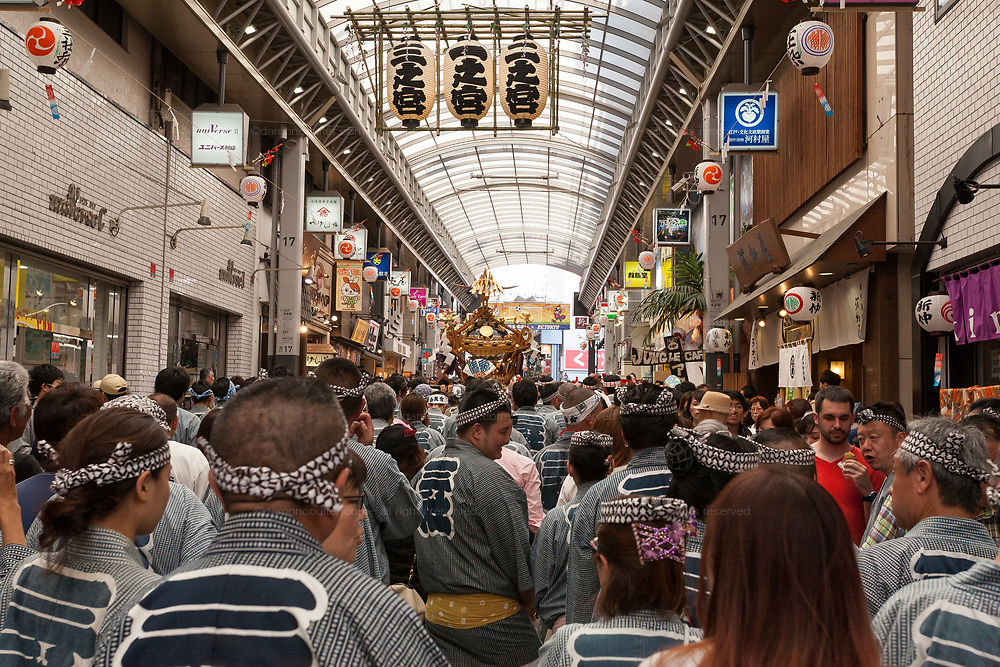 A mikoshi is carried through the a covered shopping street during the Sanja matsuri, Asakusa, Tokyo, Japan. Sunday May 21st 2017. The Sanja matsuri (Three shrines festival) is one of the biggest Shinto festivals in Japan. It takes place for 3 days around the third weekend of May and features over 100 large and small mikoshi, or portable shrines, which are paraded around the streets of the historic Asakusa district in Tokyo. to bring blessings and good luck on the inhabitants. The events attracts up to 2 million visitors each year.