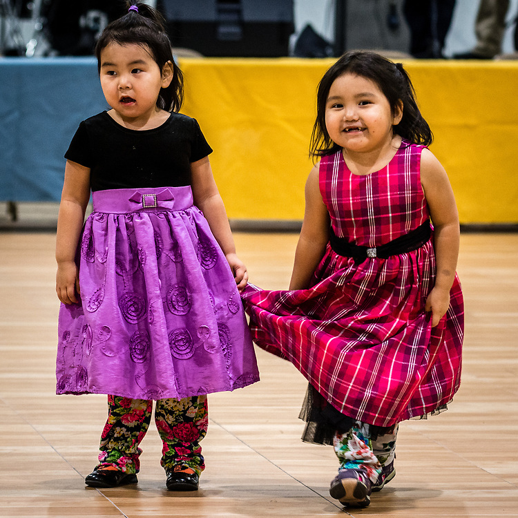Two young girls dancing at the recreational center, before the dance competition.