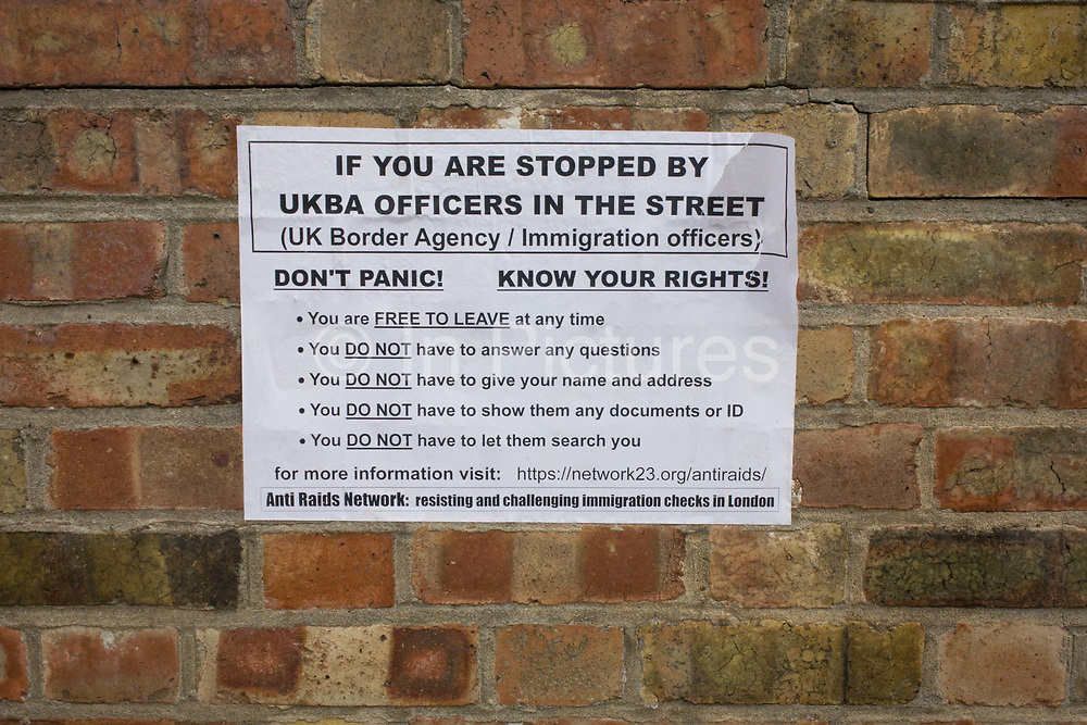"""Raid or search advice printed on a sheet and pasted to a Southwark wall, aimed at immigrants or asylum seekers stopped by the now defunct UK Border Agency and issued by network23.org, an anti-raids network - """"Free anonymous WordPress blogs for activists and agitators."""" A bullet-point list of dos and don'ts advises those affected by a stop and search by immigration officials, telling them their rights and other information and including details of the network's web address."""