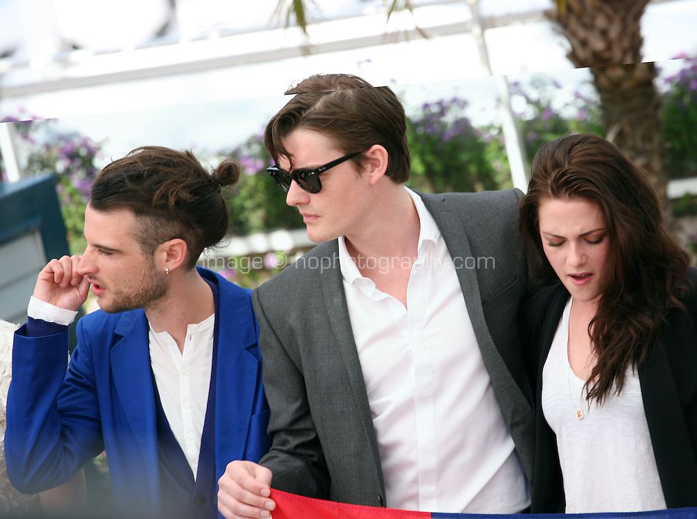 Tom Sturridge, Sam Riley, Kristen Stewart  at the On The Road photocall at the 65th Cannes Film Festival France. The film is based on the book of the same name by beat writer Jack Kerouak and directed by Walter Salles. Wednesday 23rd May 2012 in Cannes Film Festival, France.