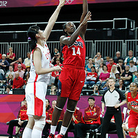 05 August 2012: USA Tina Charles goes for the layup over China Nan Chen during 114-66 Team USA victory over Team China, during the women's basketball preliminary, at the Basketball Arena, in London, Great Britain.