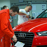 Workers assemble car belonging to the Audi TT family in the Audi factory in Gyor (about 120 km West of Budapest), Hungary on November 05, 2014. ATTILA VOLGYI