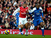 Photo: Ed Godden/Sportsbeat Images.<br /> Arsenal v Wigan Athletic. The Barclays Premiership. 11/02/2007. Arsenal's Julio Baptista (L), tussles with Emmerson Boyce.