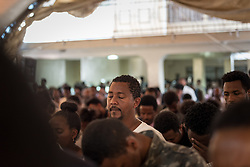 27 October 2019, Addis Ababa, Ethiopia: Congregants pray during Sunday service at the Finfinne Oromo Mekane Yesus Congregation of the Ethiopian Evangelical Church Mekane Yesus. In a context where congregations did not use to be allowed to hold their services in any language but Amharic, the congregation today is one of some 60 Oromo speaking Mekane Yesus congregations in Addis Ababa. The service takes place on the first Sunday following political turmoil in the country, claiming dozens of lives.