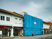 13 DECEMBER 2018 - SINGAPORE: A shophouse being gentrified in the Geylang neighberhood. The Geylang area of Singapore, between the Central Business District and Changi Airport, was originally coconut plantations and Malay villages. During Singapore's boom the coconut plantations and other farms were pushed out and now the area is a working class community of Malay, Indian and Chinese people. In the 2000s, developers started gentrifying Geylang and new housing estate developments were built.      PHOTO BY JACK KURTZ