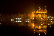 "The Golden Temple at night. Sikhism's holiest of ""Gudwaras"", places of worship, Amritsar, Punjab, India."