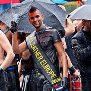 NLD/Amsterdam/20100807 - Boten tijdens de Canal Parade 2010 door de Amsterdamse grachten. De jaarlijkse boottocht sluit traditiegetrouw de Gay Pride af. Thema van de botenparade was dit jaar Celebrate, Mr. Leather Pieter Claeys