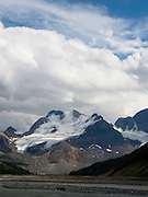 View of the snowfield just to the south of Athabasca Glacer with the Sunwapta River in the foreground, along the Icefields Parkway, Jasper National Park, Alberta, Canada, on an overcast day.