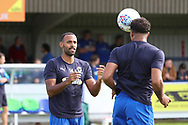 AFC Wimbledon midfielder Tom Soares (19) heading ball to AFC Wimbledon midfielder Liam Trotter (14) during the EFL Sky Bet League 1 match between AFC Wimbledon and Scunthorpe United at the Cherry Red Records Stadium, Kingston, England on 15 September 2018.