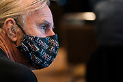 """DULUTH, MN – SEPTEMBER 9: A masked supporter looks on before Donald Trump, Jr.'s """"Make America Great Again"""" rally in Duluth, Minnesota on Wednesday, Sept. 9, 2020."""