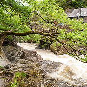 Betws-y-Coed Afon Llugwy. The Afon Llugwy (River Llugwy) rapids flowing through Betws-y-Coed after particularly heavy rainfall. Betws-y-Coed is a small village in the heart of the Snowdonia National Park that is a popular base for hikers.
