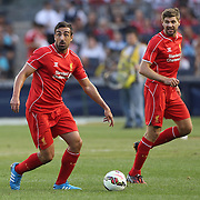 Jose Enrique, (left), and Steven Gerrard, Liverpool, in action during the Manchester City Vs Liverpool FC Guinness International Champions Cup match at Yankee Stadium, The Bronx, New York, USA. 30th July 2014. Photo Tim Clayton
