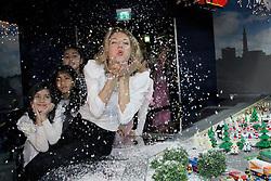 20.11.2015, Am Potsdamer Platz, Berlin, GER, Winterwunderland im LEGOLAND mit Ella Endlich, im Bild Saengerin Ella Endlich kuesst das weihnachtliche Winterwunderland im LEGOLAND wach. Das Miniland am Potsdamer Platz praesentiert im originalgetreuen Massstab 1:45 eine fantastische Lego- Weihnachtsszene mit vielen Datails, einer Weihnachtsmann- Werkstatt, einem Weihnachtsmarkt. Mit der Neuinterpretation *Kuess mich, halt mich, lieb mich* aus dem tschechisch- deutschem Maerchenfilm *Drei Haselnuesse fuer Aschenbroedel* kuesst Ella Endlich die Weihnachtswelt mit einem kleinen Schneesturm wach. Selbst die beruehmten 3 Haselnuesse wurden aus Legosteinen Gebaut. Ab Mitte November koennen Sie mit ihren Kindern im Legoland Discovery Centre Berlin das neue Winterwunderland in Berlin bestaunen. // Singer Ella Endlich kisses awake the Christmas Winter Wonderland at LEGOLAND. The Miniland at Potsdamer Platz presents the faithful scale of 1:45 a fantastic Lego Christmas scene with many Datails, a Santa Claus Workshop, a Christmas market. With the reinterpretation * kiss me, hold me, love me * from the Czech-German Maerchenfilm * Three hazelnuts for Cinderella kisses * Ella Endlich the Christmas world with a small snowstorm awake. Even the famous 3 Haselnuesse were built of Lego bricks. From mid-November you can admire with their children in the Legoland Discovery Centre Berlin, the new Winter Wonderland in Berlin. Am Potsdamer Platz in Berlin, Germany on 2015/11/20. EXPA Pictures © 2015, PhotoCredit: EXPA/ Eibner-Pressefoto/ Katz<br /> <br /> *****ATTENTION - OUT of GER*****