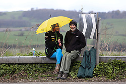 © Licensed to London News Pictures. 30/04/2016. Harewood, UK. Two spectators try to stay dry as they wait for the riders to ascend the climb in Harewood near Leeds in West Yorkshire during the second stage of the 2016 Tour De Yorkshire. The three-day road cycling race held annually across Yorkshire is in it's second year. Photo credit : Ian Hinchliffe/LNP
